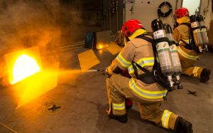 RAN Royal Australian Navy marine fire training on HMAS Canberra HMAS Adelaide